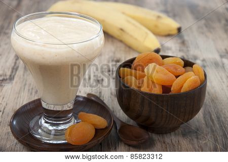 Smoothies Of Dried Apricots And Bananas In A Glass.