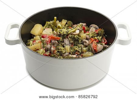Vegetables in cooking pot isolated on white background.