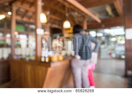 Blurry Defocused Image Of People Buying Food At Food Court
