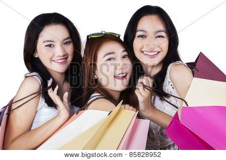 Gorgeous Teenage Shopaholics Smiling