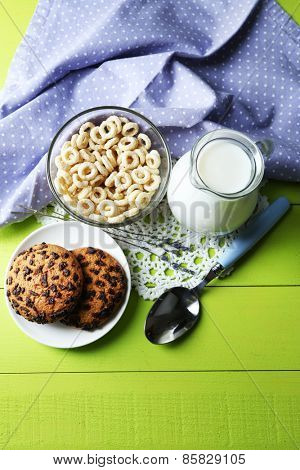 Homemade yogurt and delicious  cereals in bowl on wooden table background. Conceptual photo of healthy and tasty breakfast