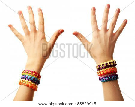 Female hands with bracelets isolated on white