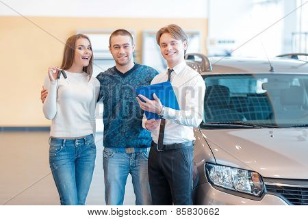 Couple talking to sales consultant in showroom