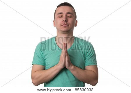 Portrait Of Handsome Young Man Meditating White Background