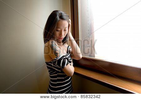 Beautiful Sensual Asian Woman Posing Thoughtful At Window