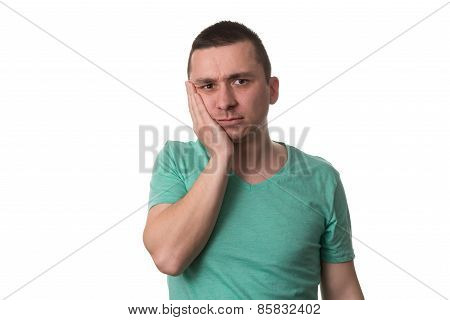 Young Man With A Toothache On White Background