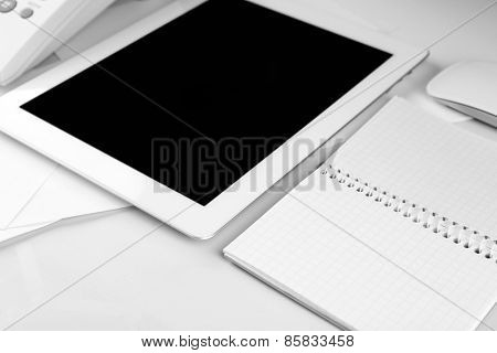 Office workplace with tablet close up