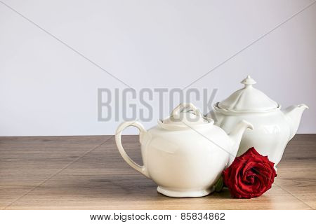 old ceramic teapot with rose