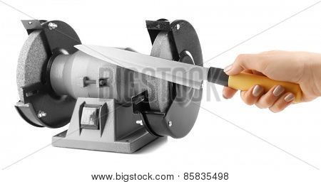Sharpening knife process isolated on white
