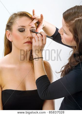 Makeup Artist Applying Makeup On Model
