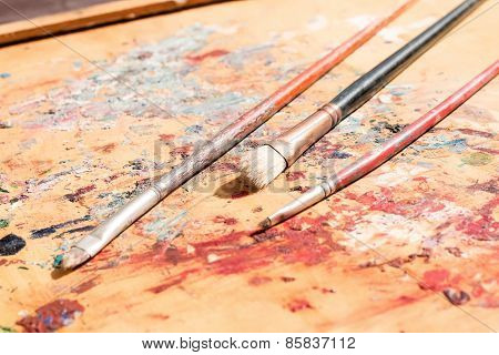 Three Old Paintbrushes