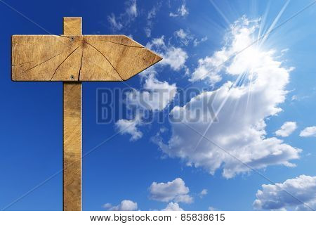 Wooden Directional Sign On Blue Sky