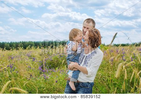 Young Attractive Parents And Child Portrait Outdoors