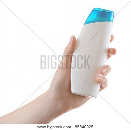 Female hand with cosmetics bottle isolated on white