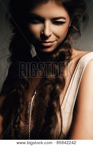 Charming Woman With Fluffy Braids