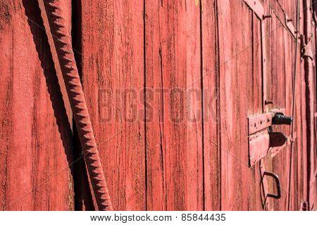 Metal Rod And Red Wood Garage Door