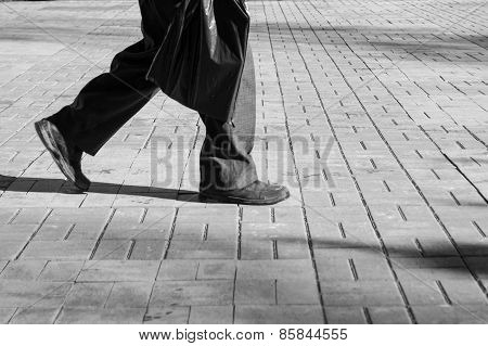 Solitary Male Footsteps