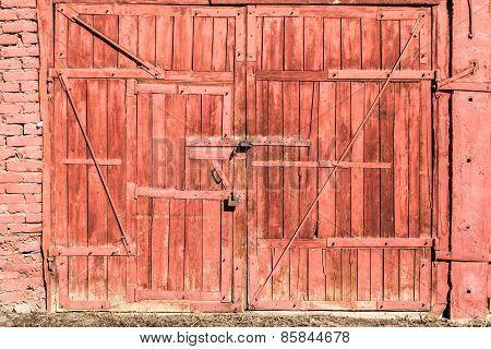 Red Wooden Garage Door With Padlock