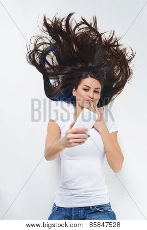 Woman lying on her back and using phone