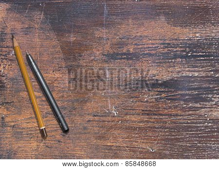 Pencils on a old wood table