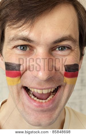 German Fan With Face Painted