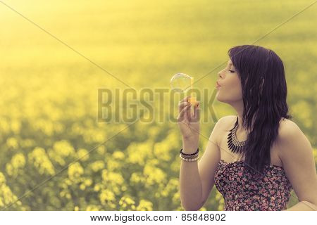 Beautiful Woman Blowing A Single Soap Bubble In Summer Nature