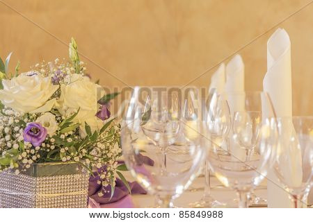 Premium Dinner Gala Table With Flowers Napkins And Glasses In Row