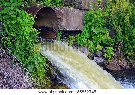 Discharge Of Water From The Pipe In The River