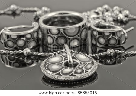 Set of silver jewelry. Black and white photo