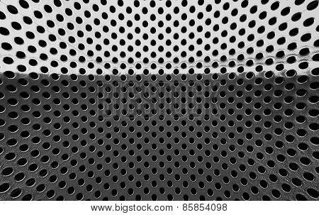 Metal Grille With A Hole.
