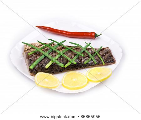 Close up of grilled carp steak.
