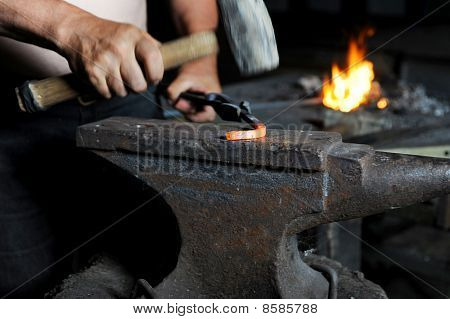 Blacksmith Forges Iron