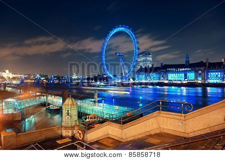 LONDON, UK - SEP 26: London Eye over Thames River at night on September 26, 2013 in London, UK. It is Europe's tallest Ferris wheel and the most popular paid tourist attraction in UK