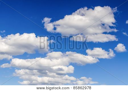 Beautiful Blue Sky With White Fluffy Clouds