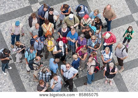 Top View Group Of Unknown Tourists Waiting At The Old Town Square In The Center Of Prague, Czech Rep