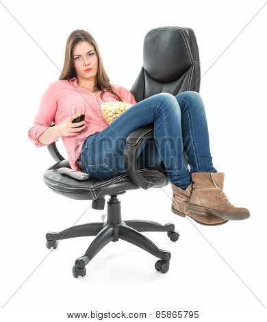 Lazy Woman Sitting Stretched Out In An Armchair With Popcorn And A Drink