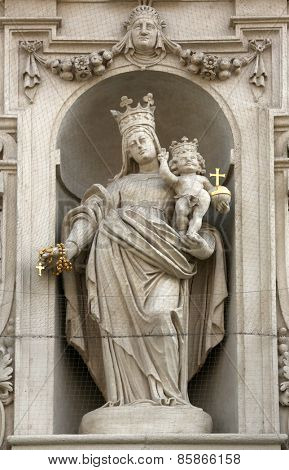 VIENNA, AUSTRIA - OCTOBER 10: Virgin Mary with baby Jesus on the facade of Dominican Church in Vienna, Austria on October 10, 2014. Famous baroque church was completed in 1634.
