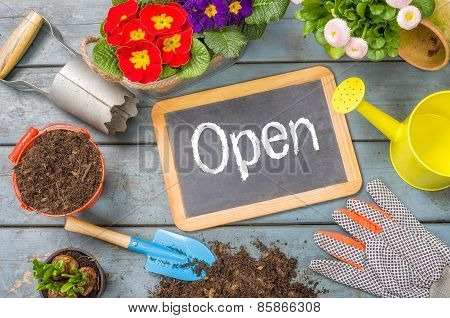 Blackboard On A Plant Table With Garden Tools - Open