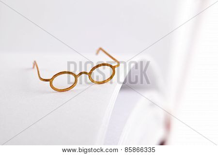 Reading Glasses On A White Page