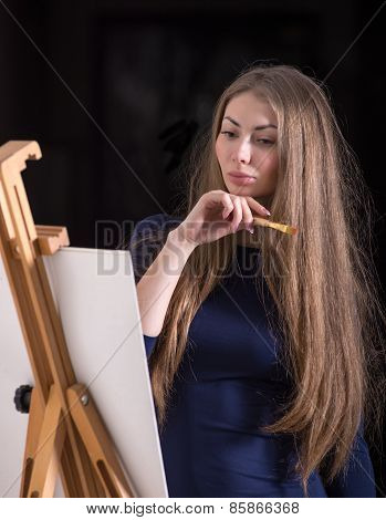 Woman And Easel..