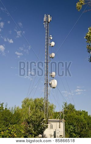 Tower Of An Antenna And The Blue And Cloudy Sky