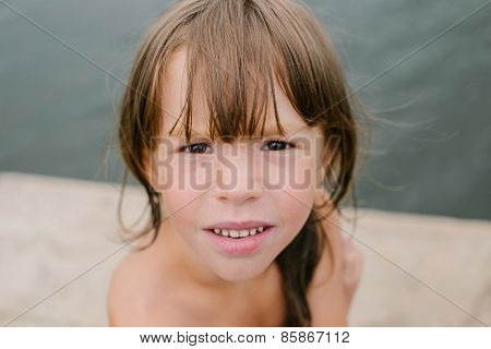 Little girl at the beach on hot summer day
