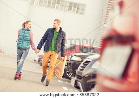 Couple Walking On Parking After Shopping