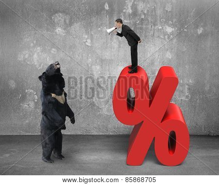 Businessman Using Megaphone Yelling At Black Bear On Percentage Sign