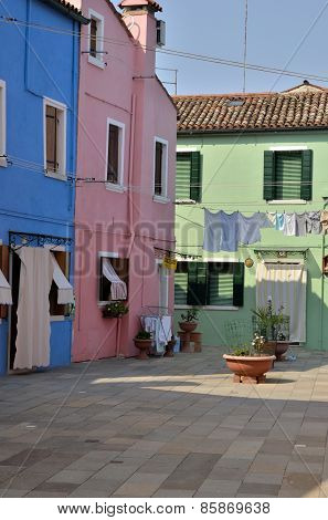 Colorful Houses In Small Plaza
