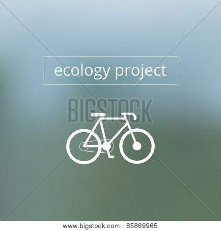 Ecology project text with bicycle on blurred background.