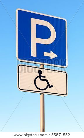 Close-up Of A Handicapped Parking Sign Against Blue Sky