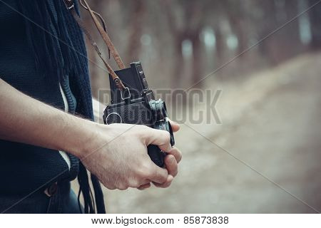 Retro Stylized Photo Of Young Man Photographer With Vintage Camera