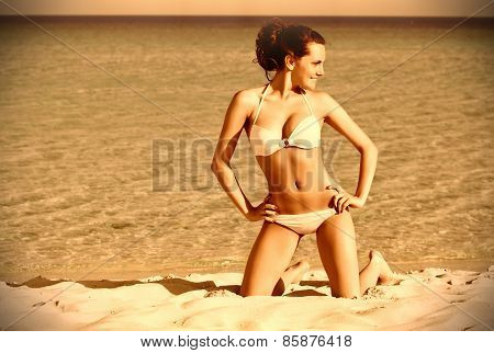 A woman is on the beach
