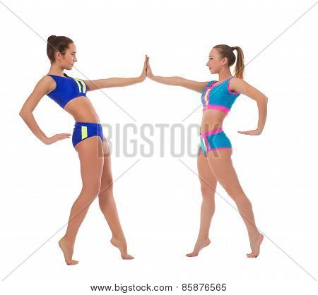 Image of graceful gymnasts practicing in dance